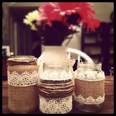 DIY center pieces. These are made from recycled sauce and pickle jars. Have fun hot gluing burlap, twine, and lace. These are the first of my MANY center pieces for my wedding.