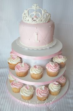 "This cake & cupcakes were for my cousin's grand-daughter...also my cousin for her first birthday. She wanted pink & white with a ""royal"" theme."