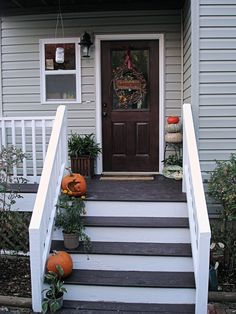 I like the dark stain porch with the white risers.