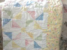 Pastel Pinwheels and Balloons Baby Quilt. $95.00, via Etsy.