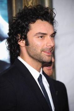 Aidan Turner. Love his hair!