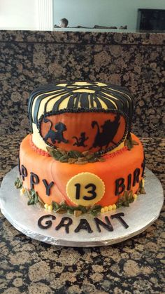 Cake inspired by the Lion King play bill and movie.  Birthday boy requested a mult-colored orange fondant.