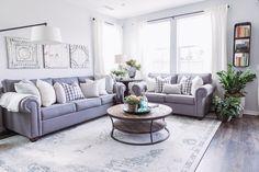 PURE SALT INTERIORS // ARIA PROJECT // LIVING // grey sofa, potted plants, vintage shelf, vintage books....