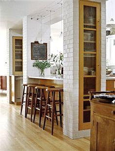 kitchen pass thru + storage + white tile
