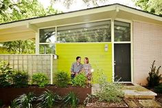Mid century bright colour entry shallow pitch roof angled windows