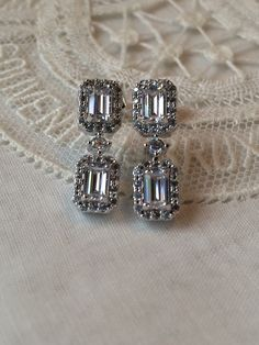 A personal favorite from my Etsy shop https://www.etsy.com/listing/226358391/emerald-cut-earrings-vintage-inspired