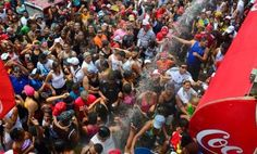 Carnaval street parties in Panama City. The water is much appreciated after hours of dancing in the hot Panamanian sun.
