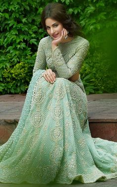 This designer lehengais featured in mint green color gorgette with hand embroideredzardozi work. Embroidery is in dabka, diamontale and silk threads. This des