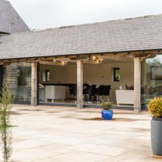 Home Farm, Shropshire Barn Conversion Exterior, Barn Conversion Kitchen, Barn Conversions, Barn Windows, Stone Patio Designs, Rustic Shed, Patio Plans, Willow House, Barn Kitchen