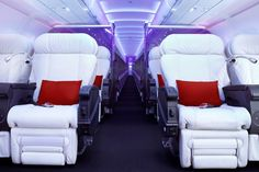 Virgin America's first class features mood lighting and white leather seats.