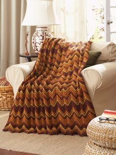 Free Pattern - Keep out the chill with this cozy #crochet Ripple Afghan in Waverly for Bernat.