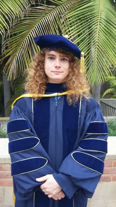 UCLA Graduate wearing Doctoral Regalia from capgown.com