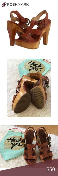 """Frye Tamara Buckle Leather T-Strap Clogs Heels Still in good pre-loved condition leather heels shoes from Free in size 7.5. Some wears to the shoes, but still lots of life left. Heels meSure about 5.5"""" with 1.5"""" platform support. Leather with wood details. ❌No trades or modeling. Open to reasonable offers. Bundle and save 15% or more. Thank you‼️ Frye Shoes Heels"""