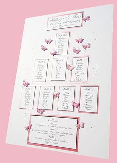 Wedding-table-plan-in-handwritten-calligraphy-pink-and-white-butterflies-with-crystals