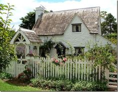 cedar shake roofs, white picket fence, cream painted house