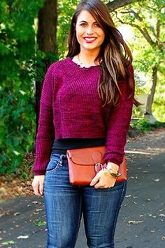Lengthen your torso by wearing a longer fitted shirt underneath a cropped sweater:   17 Super Useful Styling Tips For Women Under 5'4
