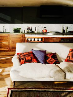 Tribal print pillows and wood kitchen