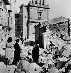 Robert Capa in Italia. After an air raid by the allies. Agrigento, 17 – 18 July 1943. #WWII #history #photography