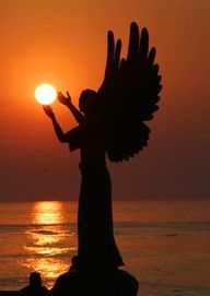 Angel Holding The Sun.....All I see is a weeping angel trying to blot out the sun and kill us all...DON'T BLINK