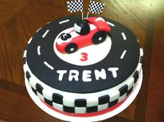 Race Car Birthday Party Cake - The Motor Show 4th Birthday Cakes, Race Car Birthday, Race Car Party, Birthday Ideas, Hot Wheels Party, Car Themed Parties, Cars Birthday Parties, Race Car Cakes, Party Deco