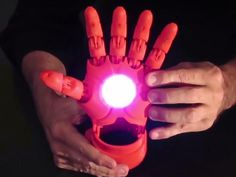 A child-sized 3D-printed prosthetic hand packs in LEDs for a light-up thruster, Bluetooth, an Arduino and options for a whole bunch of cool Iron Man tech.