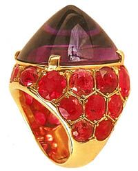 A ring that Suzanne Belperron created in 1935 witha large cabochon amethyst and red tourmalines.