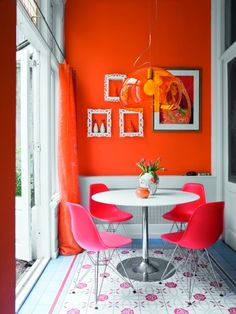 Orange wall and white frames. Love.  Photo by Brigitta Wolfgang Drejer for Bolig