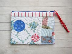 Rosy sky blue and red patchwork quilted zipper pouch by poppyshome, $22.00