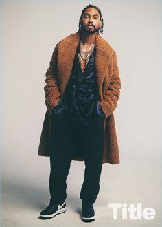 Singer Miguel wears a Stella McCartney coat with a Vivienne Westwood jacket.