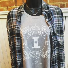 For everyone who loves Lake Days!! Plaid shirt- $29.95 Bell & May Lake shirt- $32 Kendra Scott Elisa necklace- $65  #madisonsbluebrick #downtownhotsprings #bellandmay #madforplaid #kendrascott