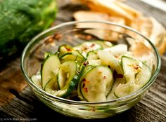 Marinated Cucumber Salad  2 cucumbers, sliced very thin 1 sweet onion, sliced very thin Marinade:  1/2 cup raw apple cider vinegar 1/2 cup water juice from 1/2 lemon 2 tablespoons organic evaporated palm coconut sugar Himalayan salt and pepper 1 teaspoon chili flakes 1. Mix marinade ingredients together.  2. Toss in cucumbers and onions.  3. Let marinate overnight in refrigerator.