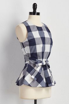A timeless #gingham print, attached belt and classic #peplum. #versona