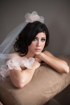 The lucy...elbow length veil with pale pink organza flowers.. $120.00 USD, via Etsy.