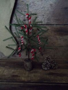 SALE--Primitive feather tree w/mini ornies~rusty bells~candy canes in Antiques, Primitives | eBay