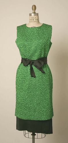 Textured green silk cocktail dress with black silk belt and underskirt, and keyhole back, by Cristobal Balenciaga, French, early 1960s.