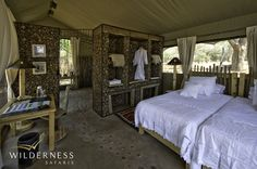 Ruckomechi Camp accommodates guests in ten spacious en-suite tented units, including a honeymoon suite, all of which overlook the Zambezi River.  #Africa #Safari #Zimbabwe #WildernessSafaris