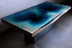 Lose yourself inside the Abyss Table's mesmerizing ocean depths