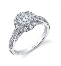 Style #SY924  3/4 Carat Diamond Engagement Ring    This unique 18K white gold engagement ring features a 0.75 carat round brilliant center diamond. Accentuated by surrounding diamonds and diamonds continuing down the sides of the ring totaling 0.66 carats.