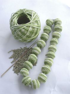 Crochet beads.  This would be nice done with Jute into a long strand to decorate Christmas tree.