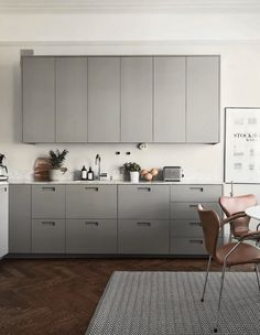 Minimal kitchen with a large dining area - via Coco Lapine Design blog