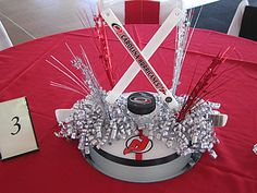 Hockey party centerpiece--except I'd leave out the Devils...Go Canes! Go Pens!