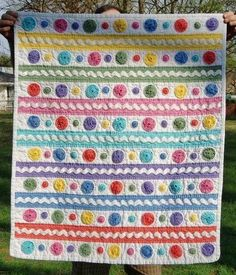 I LOVE this yo-yo and rickrack quilt! It would be so easy to make!