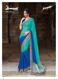 Elegance and ethnicity is what this attire reveals. It caters an indispensable color combination for everyone's wardrobe. The short net pallu with resham embroidery butti enhance its uniqueness. The saree is also covered with fancy reasham jari sequence mirror work border. Unstitched blue net jacquard blouse is included with the saree.