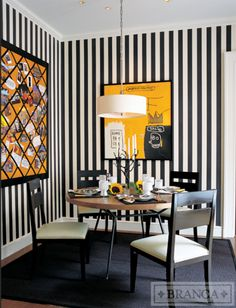 A classic black and white stripe is nearly all you need to make a dining area pop. Even if you don't have a dining room that is located in a separate room, you can still cover two corner walls with the paper to section it off as a spot to eat at. For stripes this bold and contrasting, choose a thicker version with lines that are even in width. This keeps the look grounded and structured. York's 3 Stripe wallpaper is a timeless pattern that works with both traditional and modern art.