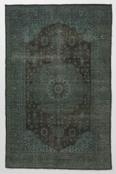 wow i love this rug. we might have to find a place for this. the muted blues and greys are calling me. $3,000.