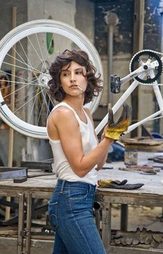 Woman working on a bicycle