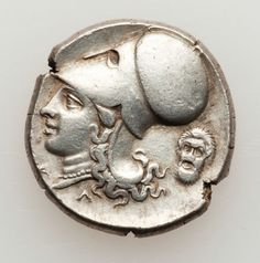 CORINTHIA. Corinth. Ca. 345-307 BC. AR stater (8.65 gm). Pegasus flying left, kappa below / Helmeted head of Athena left wearing necklace; head of Silenus behind.