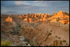 """Visual #BibleVerseoftheDay: Psalm 27:5 and the Sunrise Strikes the Landscape of Badlands National Park, South Dakota.""""In the secret place of His tent He will hide me; He will lift me up on a rock..."""" CLICK THE PHOTO to be blessed by the complete passage. http://visualverse.thecreationspeaks.com/conceal-me/"""