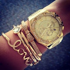 Gold stacked bracelets.