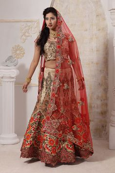 Another gem from our latest collection of bridal lehengas. Buy lehenga online - http://www.aishwaryadesignstudio.com/striking-gold-lehenga-with-pink-orange-detailing